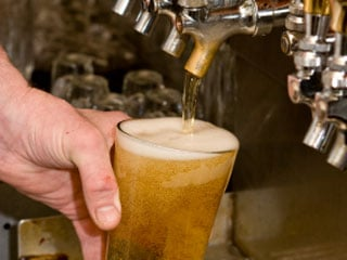 Although it's nice to hear that you can drink a beer or two a day, it's important to consider whether the health benefits are worth the risks. (©iStockphoto.com/Gene Krebs)