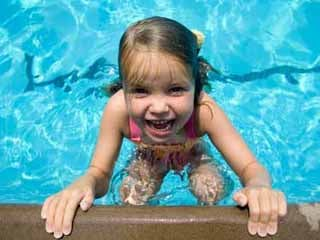 Be sure to keep a close eye on your children when they're playing at the beach or in the pool. (©iStockphoto.com/David Winters)