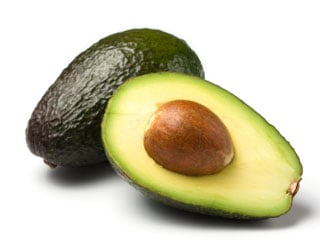 Healthy fats trigger chemicals in the brain to tell your brain that you're full. These fats can be found in avocados, nuts and olive oil. (©iStockphoto.com/Oliver Hoffmann)
